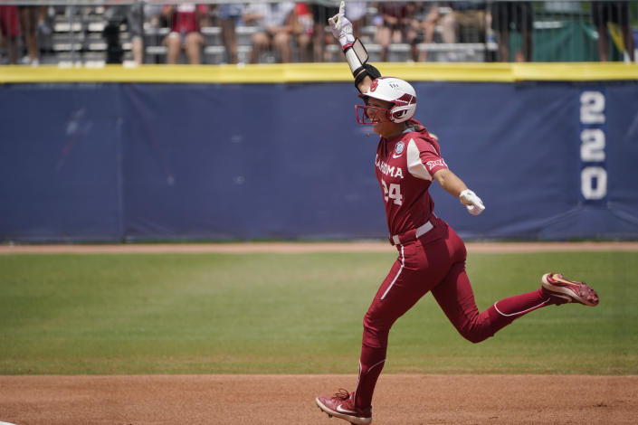 Oklahoma's Jayda Coleman (24) celebrates as she runs around the bases with a home run in the second inning of the final game of the NCAA Women's College World Series softball championship series against Florida State, Thursday, June 10, 2021, in Oklahoma City. (AP Photo/Sue Ogrocki)
