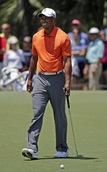 Tiger Woods walks past his ball after missing a birdie putt on the first green during the first round of The Players championship golf tournament at TPC Sawgrass, Thursday, May 9, 2013, in Ponte Vedra Beach, Fla. (AP Photo/Chris O'Meara)