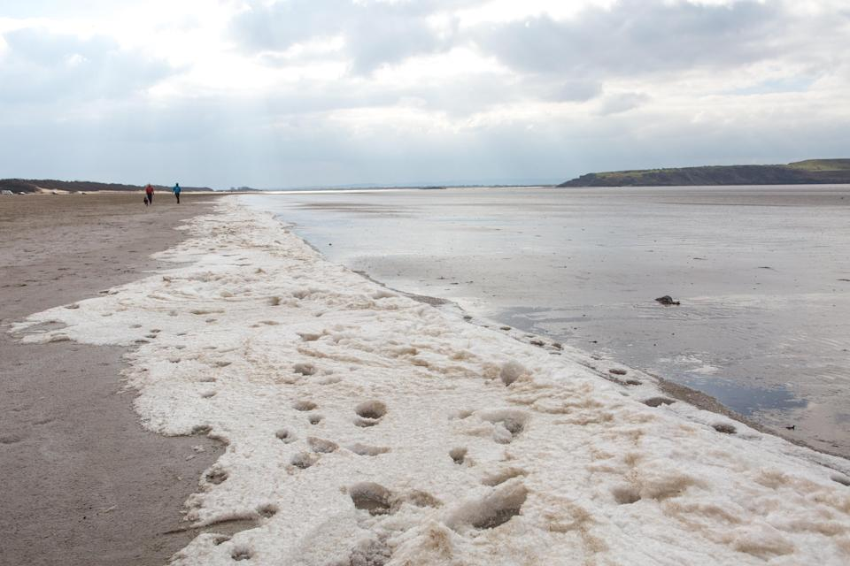 <p>Ian said: 'We were amazed to discover that there was a long swathe of ice crystals built up on the sand where the tide had come in overnight and frozen.' </p>