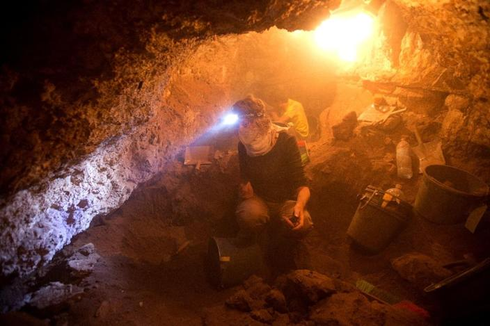 The project to search for archaeological artifacts at a cave in the Tzeelim Canyon above the Dead Sea in the Judean Desert began three weeks ago, with the Israel Antiquities Authority (IAA) hoping to extend it to more locations Israeli and foreign volunteers take part in an excavation in search for archaeological artifacts at a cave in the Tzeelim Canyon above the Dead Sea, in the Judean desert in Israel, on June 1, 2016. (AFP Photo/Menahem Kahana)