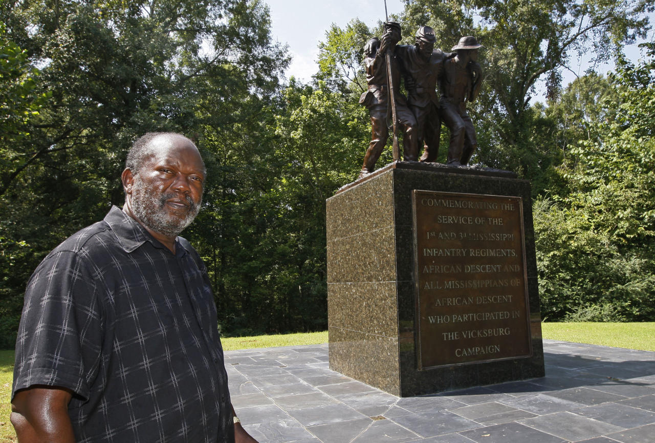 Robert M. Walker, a historian who became Vicksburg's first black mayor in the late 1980s, stands before the first monument within the national park system and the only one in the Vicksburg National Military Park, that honors all black people _ free and slave _ who participated in military action in Vicksburg during the Civil War, Thursday, Aug. 16, 2012, in Vicksburg, Miss. Walker was instrumental in helping get the monument in 2003. Black soldiers fought for the Union in the Battle of Milliken's Bend, La., on June 7, 1863, just up the Mississippi River from Vicksburg. The site was a supply and communication post for the Union as it worked to conquer Vicksburg. (AP Photo/Rogelio V. Solis)