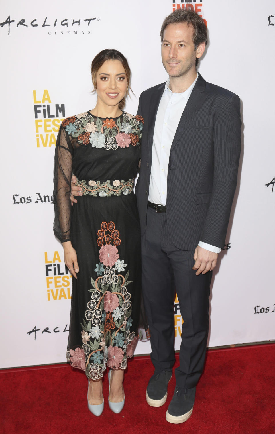 """FILE - In this Monday, June 19, 2017, file photo, Aubrey Plaza, left, and Jeff Baena arrive at the premiere of """"The Little Hours"""" at the 2017 Los Angeles Film Festival in Culver City, Calif. Plaza has married her longtime boyfriend, director and screenwriter Baena. The """"Parks and Recreation"""" actor called Baena """"my husband"""" for the first time publicly Friday, May 7, 2021, in an Instagram post. (Photo by Willy Sanjuan/Invision/AP, File)"""