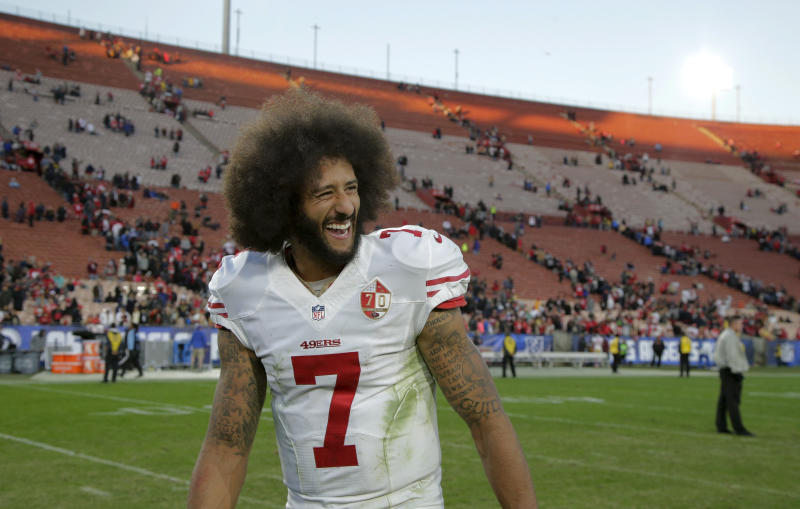 San Francisco 49ers quarterback Colin Kaepernick smiles after the 49ers' 22-21 win over the Los Angeles Rams during an NFL football game Saturday, Dec. 24, 2016, in Los Angeles. (AP Photo/Jae C. Hong)