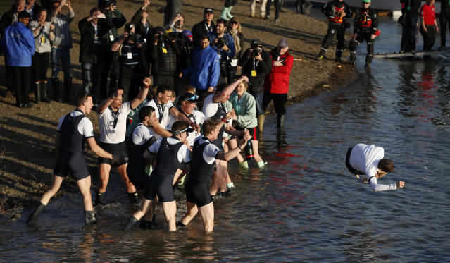 Britain Rowing - 2017 Oxford v Cambridge University Boat Race - River Thames, London - 2/4/17 Oxford's Sam Collier is thrown into the water by his crew after winning the men's Boat Race Action Images via Reuters / Paul Childs Livepic