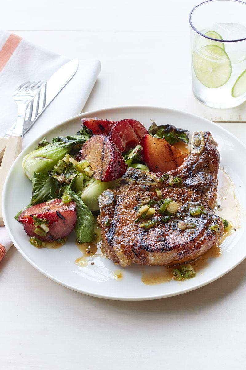 """<p>Juicy plums give much-needed sweetness to this savory summer dinner.</p><p><em><a href=""""https://www.womansday.com/food-recipes/food-drinks/recipes/a55282/grilled-pork-chops-with-plum-and-bok-choy-recipe/"""" rel=""""nofollow noopener"""" target=""""_blank"""" data-ylk=""""slk:Get the Grilled Pork Chops with Plum and Bok Choy recipe."""" class=""""link rapid-noclick-resp"""">Get the Grilled Pork Chops with Plum and Bok Choy recipe.</a></em></p>"""