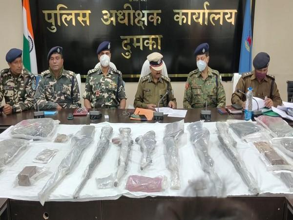 Security forces with the seized consignment in Dumka