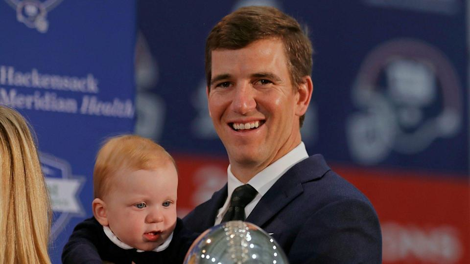 Mandatory Credit: Photo by Adam Hunger/AP/Shutterstock (10963077a)New York Giants NFL football quarterback Eli Manning holds his son Charles after announcing his retirement in East Rutherford, N.