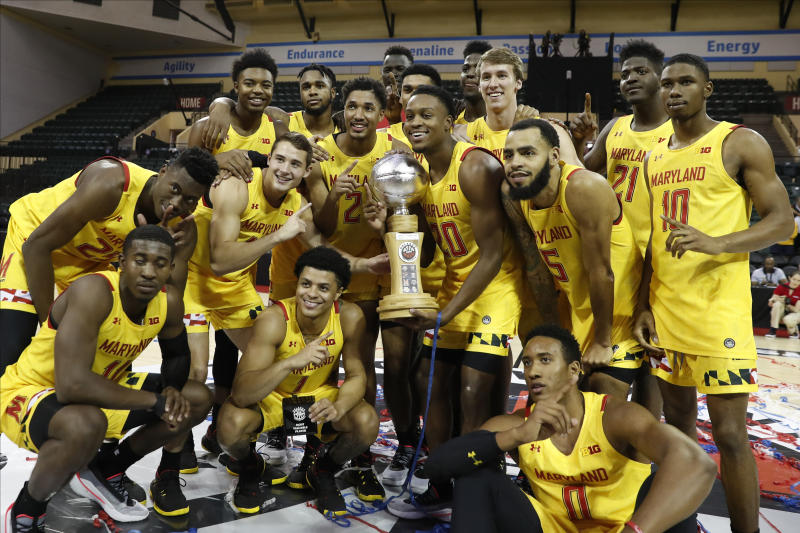 Maryland poses with the Orlando Invitational trophy after defeating Marquette during an NCAA college basketball game Sunday, Dec. 1, 2019, in Lake Buena Vista, Fla. (AP Photo/Scott Audette)