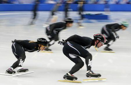 U.S. short track speed skaters Jessica Smith (L) and Chris Creveling (2nd R) practise with U.S. team members in preparation for the 2014 Sochi Winter Olympics, February 3, 2014. Sochi will host the 2014 Winter Olympic Games from February 7 to February 23. REUTERS/Alexander Demianchuk