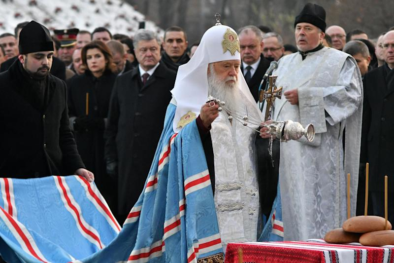 Patriarch Filaret of the Ukrainian Orthodox Church of Kiev's Patriarchate conducts a prayer during a commemoration ceremony at a monument to victims of the Holodomor famine (AFP via Getty Images)