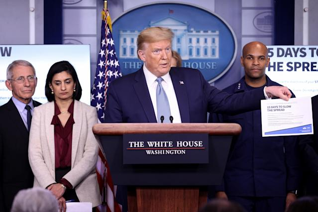 President Trump, joined by members of the coronavirus task force, speaks at a briefing at the White House Monday. (Win McNamee/Getty Images)
