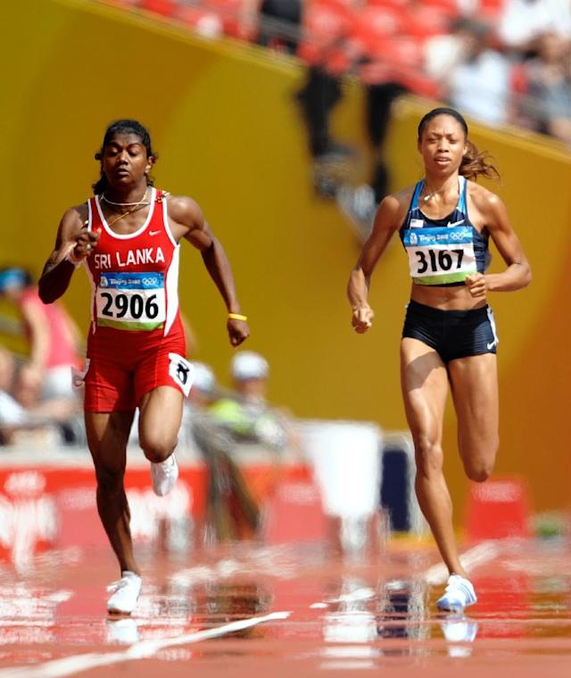 Sri Lanka's Susanthika Jayasinghe and Allyson Felix of the US compete in the women's 200m race during the 2008 Beijing Olympic Games (AFP Photo/OLIVIER MORIN)