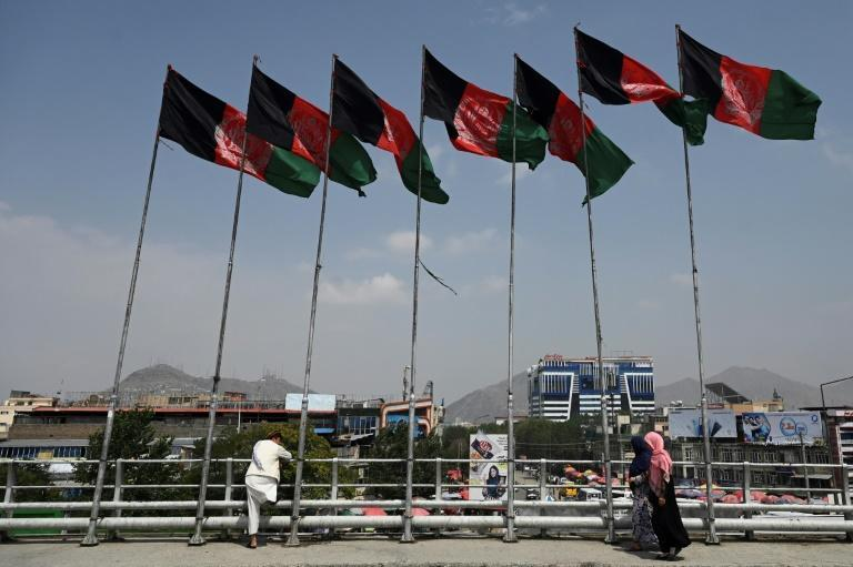 Afghan flags fluttering on masts in Kabul, where the government is struggling to counter the Taliban's latest sweeping military offensive