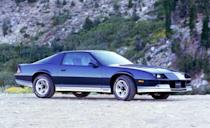 <p>Performance was returning to the Z28 by 1983 with the introduction of the 190-hp L69 version of the 5.0-liter V-8. While it still used a four-barrel carburetor, it was now available with a five-speed manual transmission. This is the '84 Camaro, which looked almost identical to the '82 and '83. GM's 700R4 four-speed automatic was optional on most Camaro models by '84.</p>