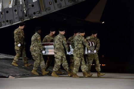 A U.S. Army carry team transfers the remains of Army Staff Sgt. Dustin Wright of Lyons, Georgia, at Dover Air Force Base in Delaware, U.S. on October 5, 2017. Courtesy Aaron J. Jenne/U.S. Air Force/Handout via REUTERS