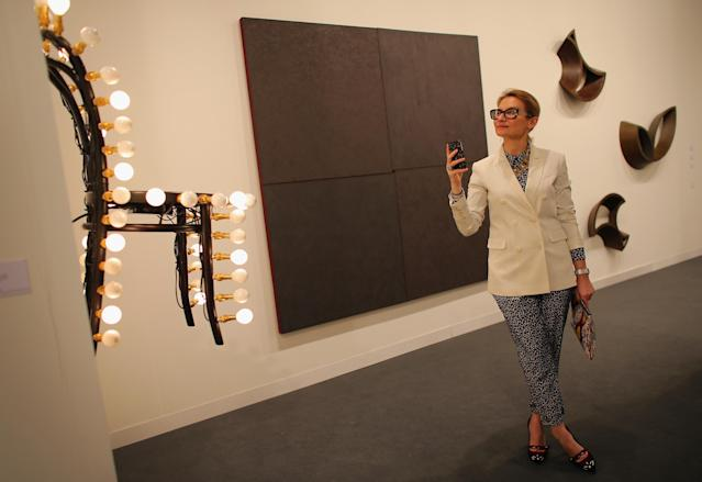 MIAMI BEACH, FL - DECEMBER 05: Evelina Khromtchenko looks at the art in a gallery as Art Basel opens at the Miami Beach Convention Center on December 5, 2012 in Miami Beach, Florida. The 11th edition of the art show runs from December 6 through the 9th. (Photo by Joe Raedle/Getty Images)