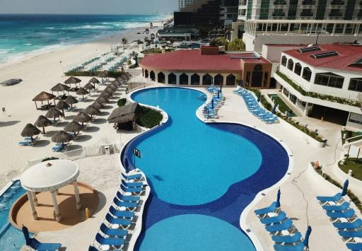 A hotel swimming pool in Cancun, pictured in March, as tourism went on hold for three months due to the coronavirus pandemic