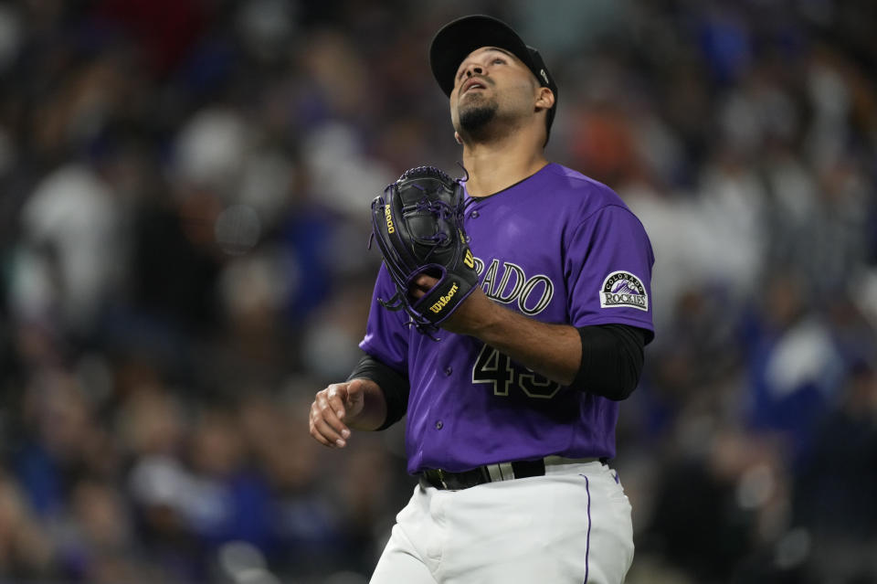 Colorado Rockies starting pitcher Antonio Senzatela reacts after getting Los Angeles Dodgers' Corey Seager to fly out to end the top of the fifth inning of a baseball game Tuesday, Sept. 21, 2021, in Denver. (AP Photo/David Zalubowski)