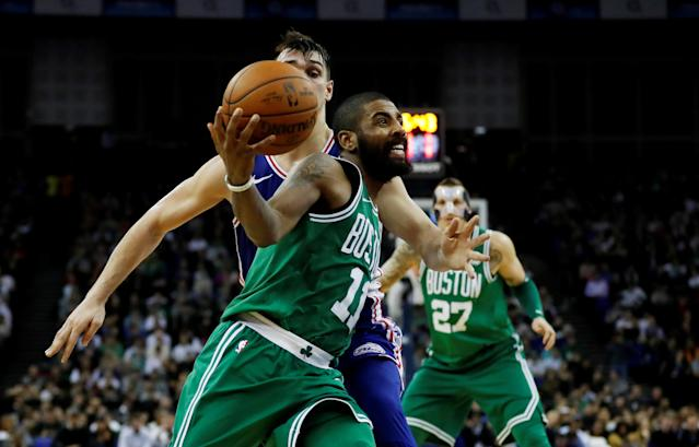 Basketball - NBA - Boston Celtics vs Philadelphia 76ers - O2 Arena, London, Britain - January 11, 2018 Boston Celtics' Kyrie Irving in action with Philadelphia 76ers' Dario Saric REUTERS/Matthew Childs