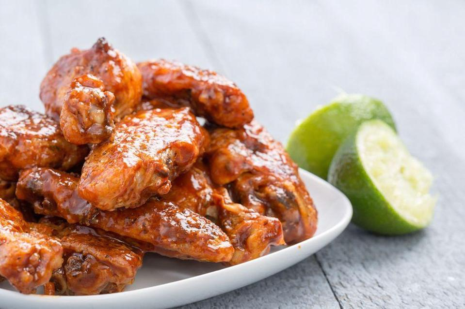 """<p>If you're the type who thinks Sriracha is spicy enough, these wings are not for you. Squeeze them with extra lime to tame the flame.</p><p>Get the <a href=""""https://www.delish.com/uk/cooking/recipes/a33592944/slow-cooker-chipotle-lime-chicken-wings-recipe/"""" rel=""""nofollow noopener"""" target=""""_blank"""" data-ylk=""""slk:Slow Cooker Chipotle-Lime Chicken Wings"""" class=""""link rapid-noclick-resp"""">Slow Cooker Chipotle-Lime Chicken Wings</a> recipe.</p>"""