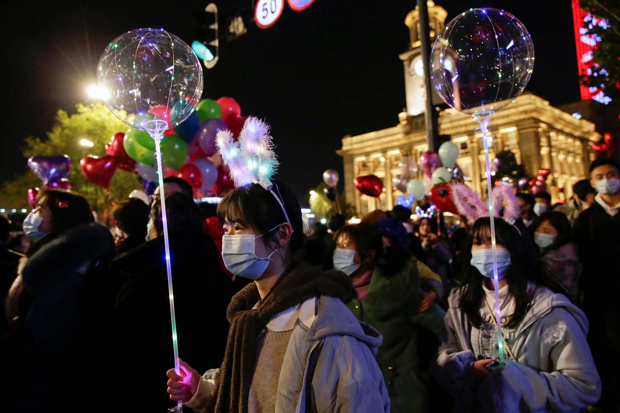 Party-goers pack into clubs in Wuhan to celebrate New Year's Eve as Brits  stuck at home