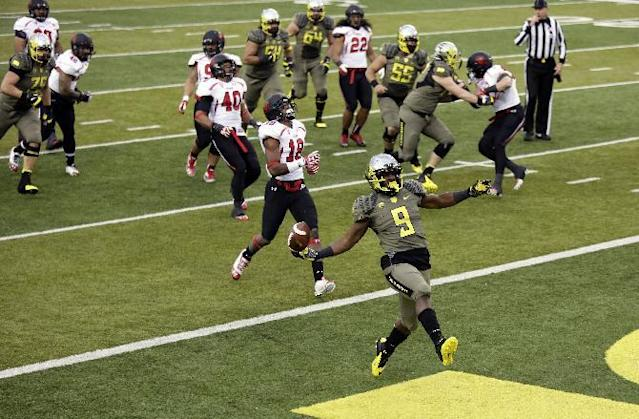 Oregon running back Byron Marshall (9) dances into the end zone during the second half of an NCAA college football game against Utah in Eugene, Ore., Saturday, Nov. 16, 2013. Oregon won 44-21. (AP Photo/Don Ryan)