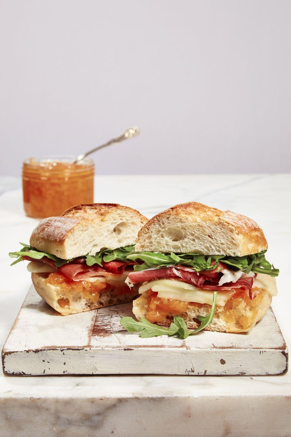 """<p>Meet the MVP of sandwiches — layers of fresh arugula, salty prosciutto, melty cheese and sweet, homemade <a href=""""https://www.goodhousekeeping.com/food-recipes/a39847/peach-honey-jam-recipe/"""" rel=""""nofollow noopener"""" target=""""_blank"""" data-ylk=""""slk:jam"""" class=""""link rapid-noclick-resp"""">jam</a> between crispy baguette slices.</p><p><a href=""""https://www.goodhousekeeping.com/food-recipes/a39853/prosciutto-melon-panini-recipe/"""" rel=""""nofollow noopener"""" target=""""_blank"""" data-ylk=""""slk:Get the recipe for Prosciutto-Melon Panini »"""" class=""""link rapid-noclick-resp""""><em>Get the recipe for Prosciutto-Melon Panini »</em></a> </p>"""