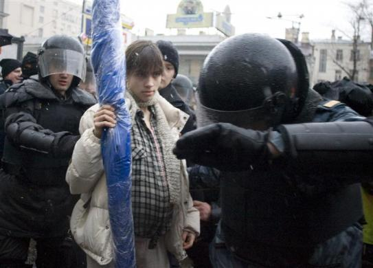 Riot police detain pregnant Nadezhda Tolokonnikova (C) during a dissenters march in Moscow March 3, 2008. Tolokonnikova later became a member of Pussy Riot.