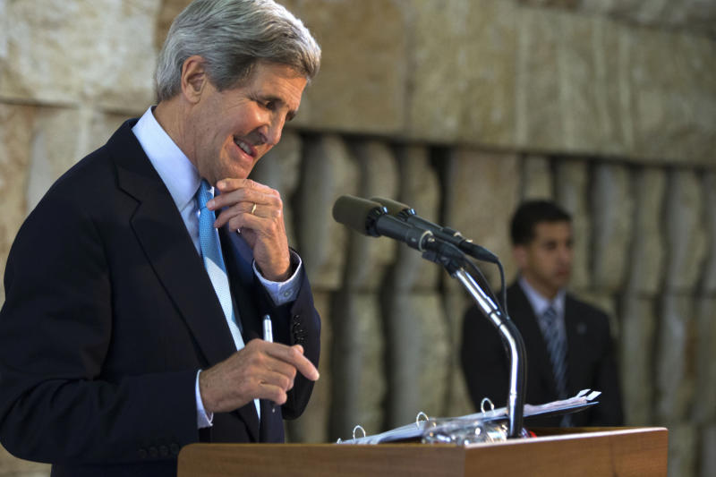 U.S. Secretary of State John Kerry smiles at a question from a reporter during a news conference about his trip to the Middle East, in Tel Aviv, Israel on Sunday, June 30, 2013. Kerry engaged in breakneck shuttle diplomacy to coax Israel and the Palestinians back into peace talks over a four-day span with multiple trips to Jordan and Israel and a stop in the West Bank town of Ramallah. (AP Photo/Jacquelyn Martin, Pool)