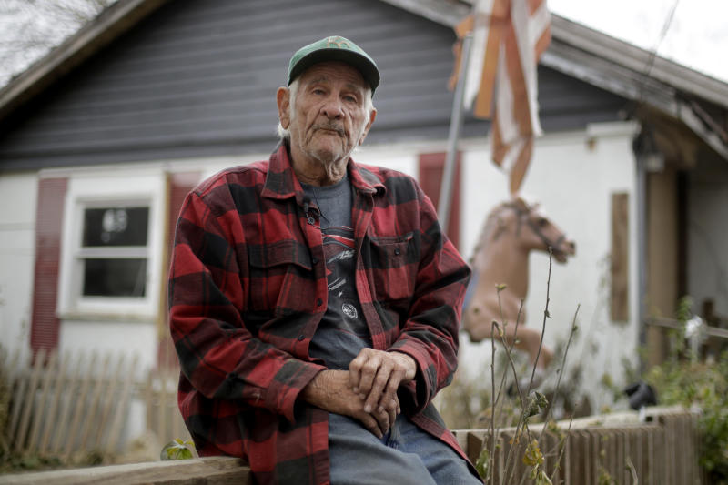 In this photo taken Monday, Nov. 18, 2019, Elmer Sullivan talks about his decision not to participate in buyout of homes in Mosby, Mo. About half of the homeowners in Mosby are participating in a government buyout in the flood-prone community, but Sullivan opted not to because the $20,000 offered for his property was not enough to afford a new home somewhere else. (AP Photo/Charlie Riedel)