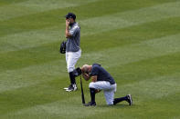 New York Yankees players react after Masahiro Tanaka was hit by a line drive during a baseball workout at Yankee Stadium in New York, Saturday, July 4, 2020. (AP Photo/Adam Hunger)
