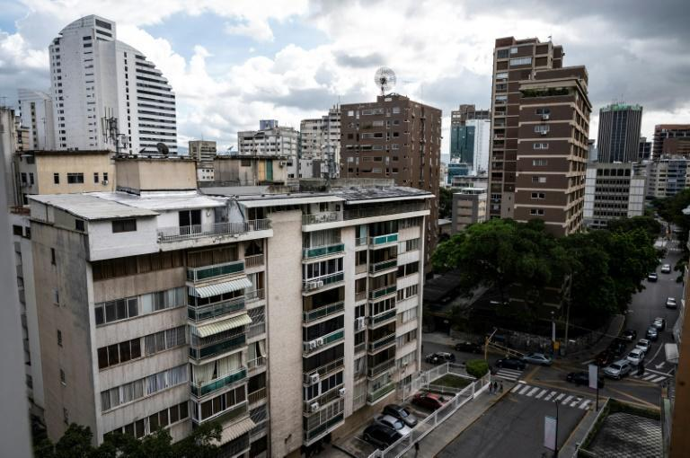 Venezuela's eye-watering inflation, hovering around 3,000 percent, means that banks are loath to risk giving out loans in bolivar (AFP/Yuri CORTEZ)