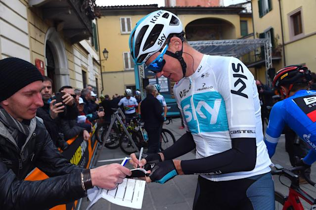 Britain's Chris Froome signs autographs prior to the second stage of the Tirreno-Adriatico cycling race, in Lido di Camaiore, Italy, Thursday, March 8, 2018. (Dario Belingheri/ANSA via AP)