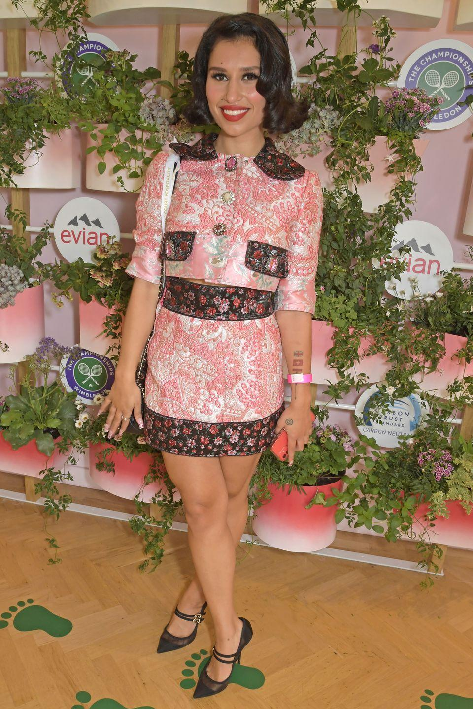 <p>Singer Raye mixed things up in a pink patterned collared dress and pointed pumps. </p>