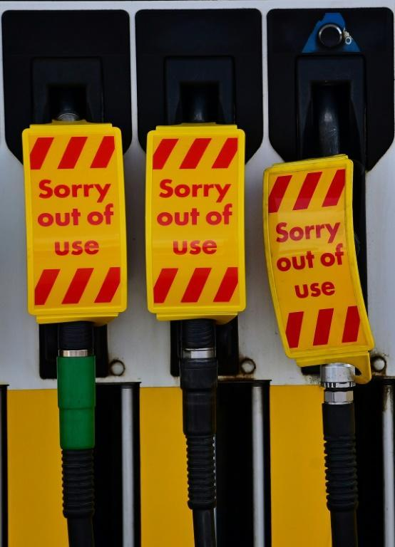 Fears about a lack of tanker drivers on fuel supplies triggered panic-buying, emptying pumps across the country (AFP/Paul ELLIS)