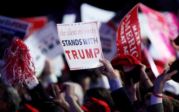 People wave signs in support of president-elect Donald Trump during his election night event in New York City on November 8, 2016. (Photo: Spencer Platt/Getty Images)