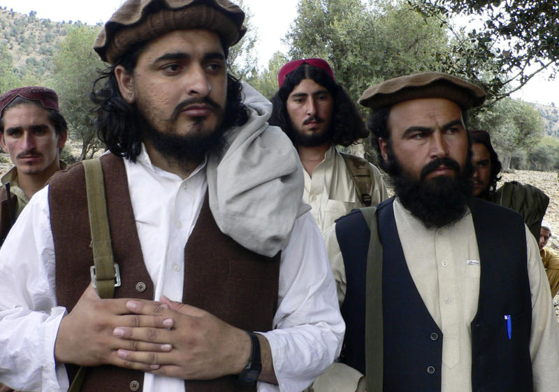 FILE - In this Oct. 4, 2009 file photo, Pakistani Taliban chief Hakimullah Mehsud, left, is seen with his comrade Waliur Rehman during his meeting with media in Sararogha, a Pakistani tribal area of South Waziristan along the Afghanistan border. Intelligence officials say the leader of the Pakistani Taliban was one of three people killed in a suspected U.S. drone strike on Friday, Nov. 1, 2013.The officials say agents sent to the site of the attack in the North Waziristan tribal area Friday confirmed the death of the militant leader, Hakimullah Mehsud. (AP Photo/Ishtiaq Mehsud, File)