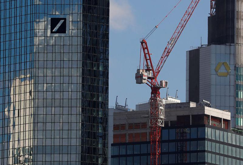 FILE PHOTO: Headquarters of Commerzbank and Deutsche Bank (L) are photographed in Frankfurt