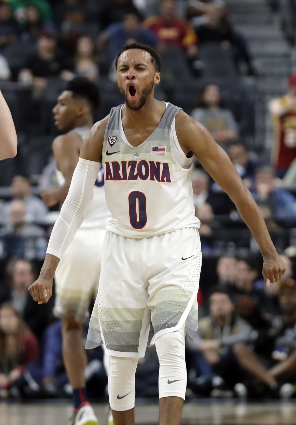 Arizona's Parker Jackson-Cartwright reacts after a basket during the second half of against Southern California in an NCAA college basketball game for the Pac-12 men's tournament championship Saturday, March 10, 2018, in Las Vegas. Arizona won 75-61. (AP Photo/Isaac Brekken)