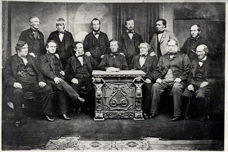The 13 members of the original Rochdale Society of Equitable Pioneers in 1865 (Creative commons)