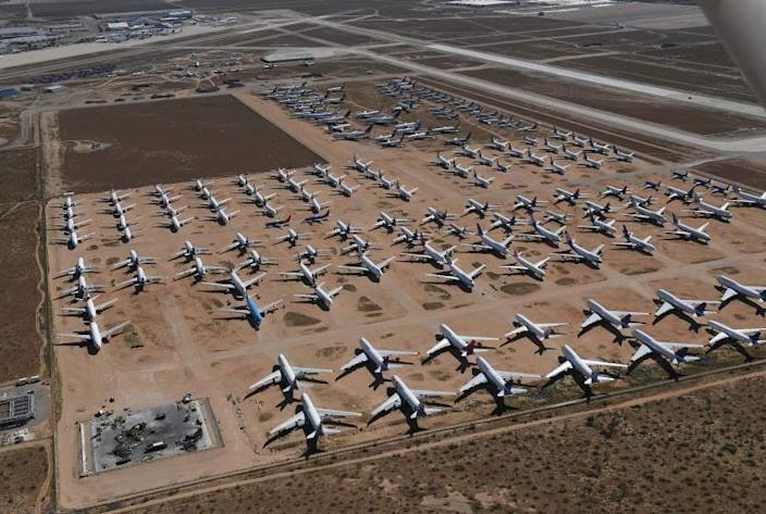 "This photo taken in March of last year shows planes from various airlines in storage at a ""Boneyard"" facility beside the Southern California Logistics Airport in Victorville, Calif. Some of the planes will be returned to service while others will be dismantled and scrapped at the facility. California with its dry desert climate is a perfect place to store surplus aircraft. <span class=""copyright"">(Mark Ralston AFP/Getty Images)</span>"