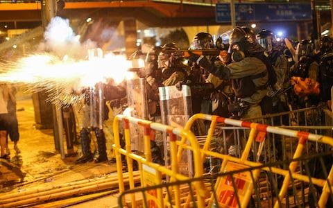 <span>Riot police fire tear gas to disperse protesters taking part in a rally on 28 July</span> <span>Credit: Rex </span>