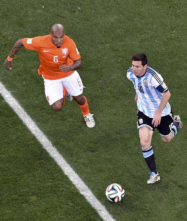 Argentina's Lionel Messi, right, is chased by Netherlands' Nigel de Jong (6) during the World Cup semifinal soccer match between the Netherlands and Argentina at the Itaquerao Stadium in Sao Paulo, Brazil, Wednesday, July 9, 2014. (AP Photo/Francois Xavier Marit, Pool)
