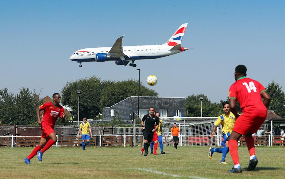 British Airways aeroplane comes in to land at Heathrow Airport during the Cherry Red Records Combined Counties Football League Division One match between Bedfont & Feltham - Catherine Ivill/Getty Images Europe