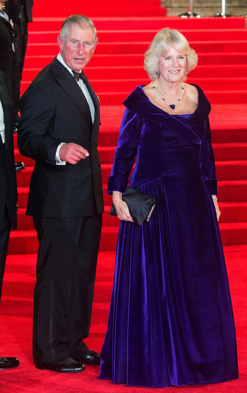 <p>The Duchess of Cornwall took to the red carpet in a velvet Bruce Oldfield gown while Prince Charles opted for a slick tux. <em>[Photo: Getty]</em> </p>