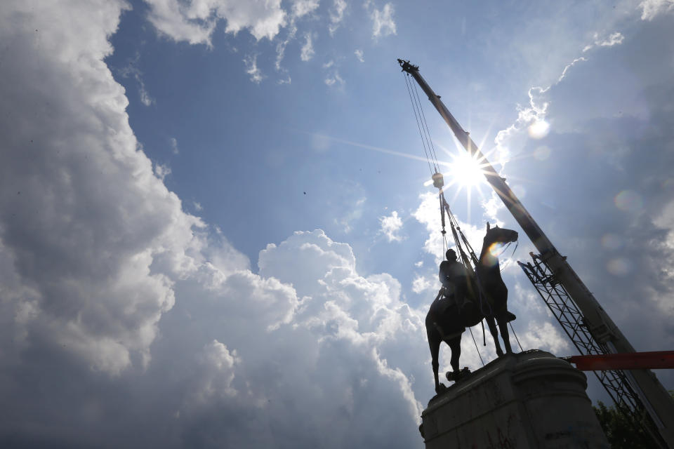 FLE - A crew works to remove the statue of Confederate Gen. Stonewall Jackson, Wednesday, July 1, 2020, in Richmond, Va. A Virginia special prosecutor has found no wrongdoing in the awarding of a $1.8 million contract for the removal of Richmond's Confederate statues last summer. The prosecutor said in a news release Wednesday, July 28, 2021, that he had reviewed the findings of a state police investigation and found no criminal activity. (AP Photo/Steve Helber, File)