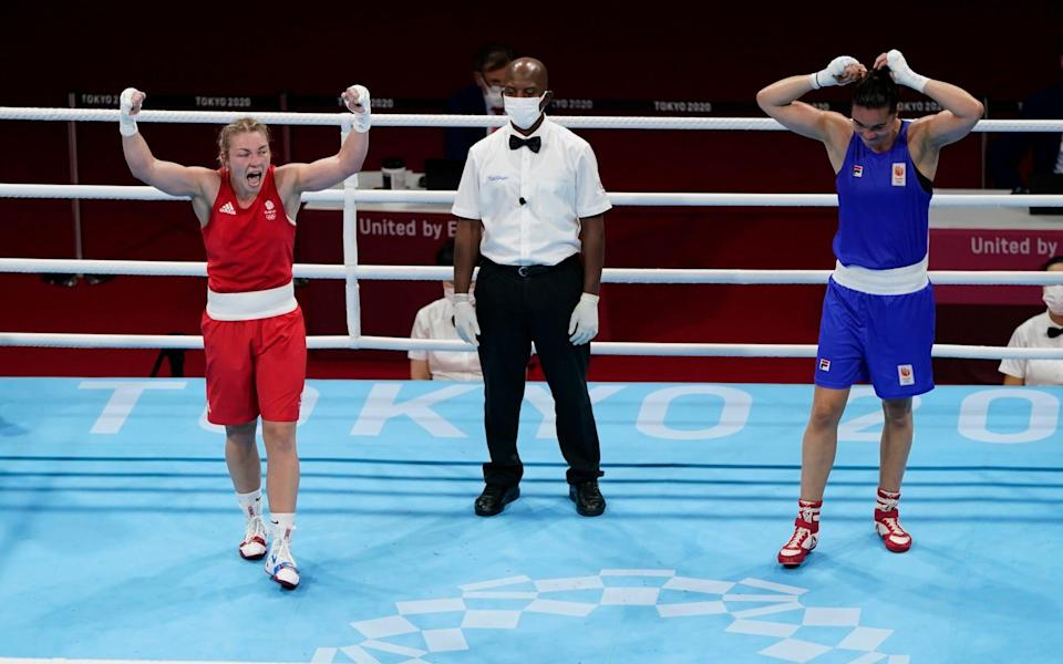 Britain's Lauren Price, left, and Nouchka Fontlijn, of the Netherlands, react after their women's middleweight 75-kg boxing match at the 2020 Summer Olympics - AP