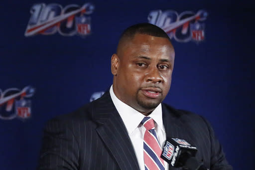 FILE - In this May 22, 2019, file photo, Troy Vincent, NFL executive vice president, speaks to the media during the owners meetings in Key Biscayne, Fla. The NFL will consult an advisory committee made up of former coaches, general managers and players on such issues as postponing, moving or even canceling games this season due to the coronavirus pandemic. Vincent said Wednesday, Aug. 19, 2020 that the advisers, who will report to Commissioner Roger Goodell, will help avoid any inequities in those decisions. Vincent did not identify any members of the panel, saying he was awaiting their approval to do so. (AP Photo/Brynn Anderson, File)