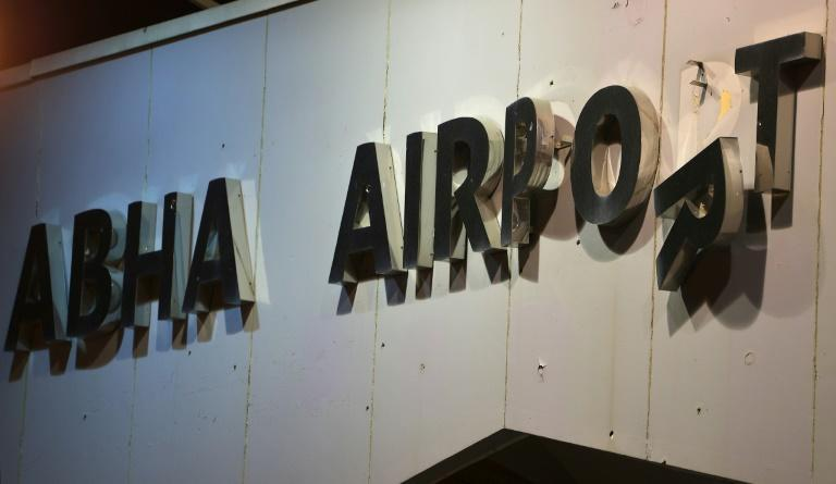 A picture shows the damaged sign at the entrance of Abha airport in the popular mountain resort of Abha in the southwest of Saudi Arabia on August 31, 2021 (AFP/Fayez Nureldine)