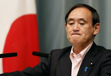 Japan's Chief Cabinet Secretary Yoshihide Suga attends a news conference at Japanese Prime Minister Shinzo Abe's official residence in Tokyo, in this file picture taken May 29, 2014. REUTERS/Yuya Shino/Files
